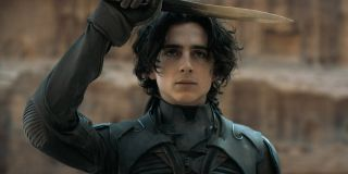 Timothee Chalamet holding knife to head in Dune movie