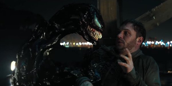 Tom Hardy looking at symbiote in Venom