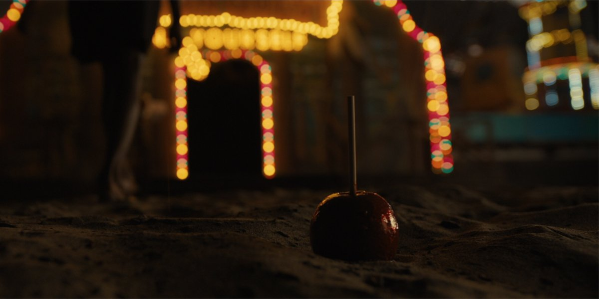 candy apple in the sand in Us