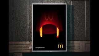 A McDonalds poster on a bus stop.