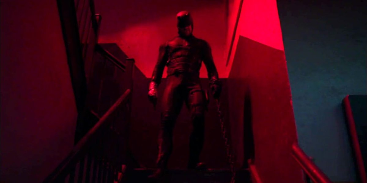 Daredevil (Charlie Cox) stands atop a stairwell on Daredevil