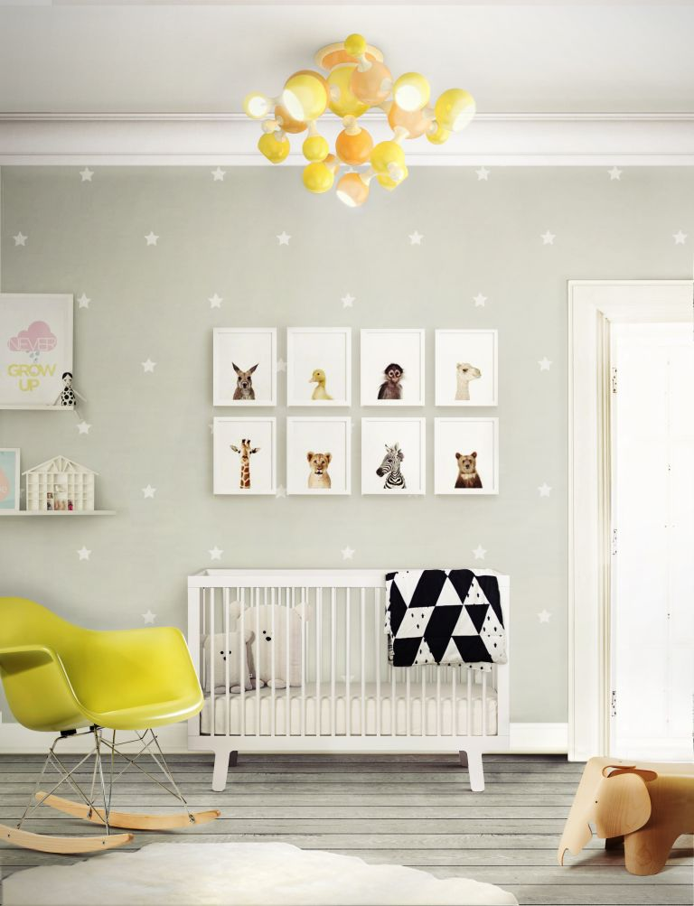 Idea of a royal baby gender-neutral nursery: Baby's nursery by Covet house with cot and chair in nursery design ideas