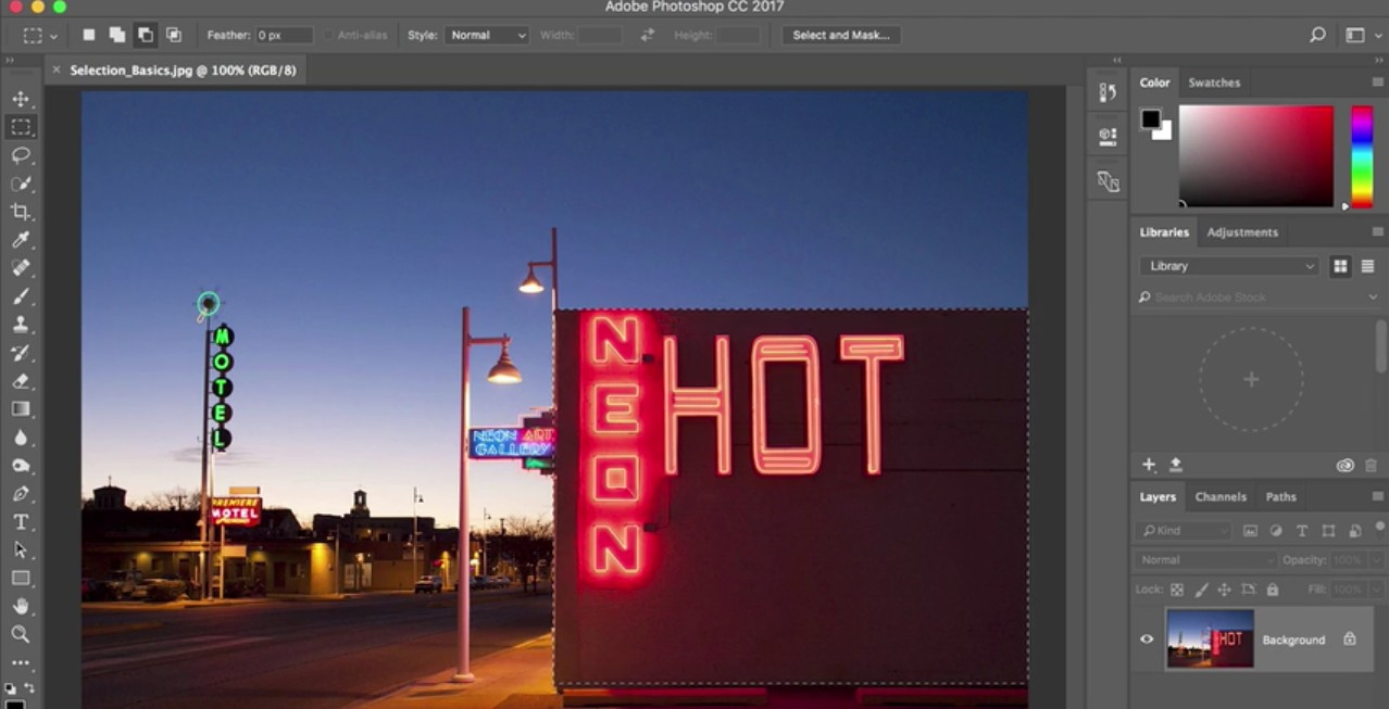 Photoshop tutorials: Photo of road featuring a number of neon hotel signs