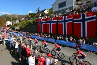 The Norway team riding past the massive flags out on course
