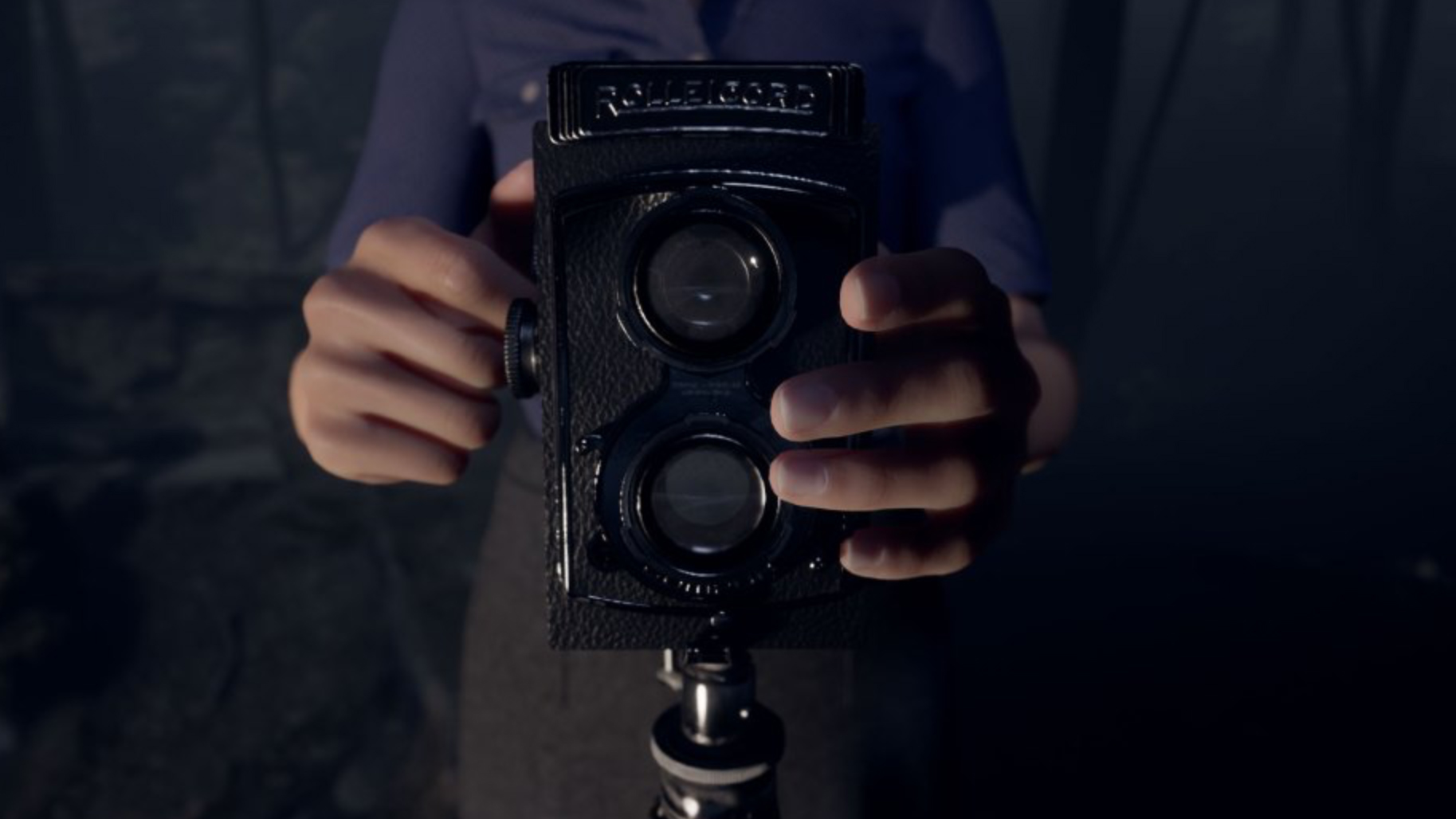 Two hands holding a camera in the game Martha is Dead