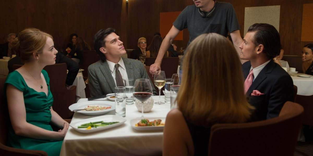 Finn Wittrock as Greg in a restaurant in La La Land.