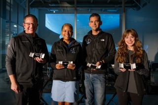 The four private astronauts of Inspiration4 received their SpaceX astronaut wings at the company's Hawthorne, California headquarters on Oct. 1, 2021. They are: (from left) Chris Sembroski, Sian Proctor, Jared Isaacman and Hayley Arceneaux.