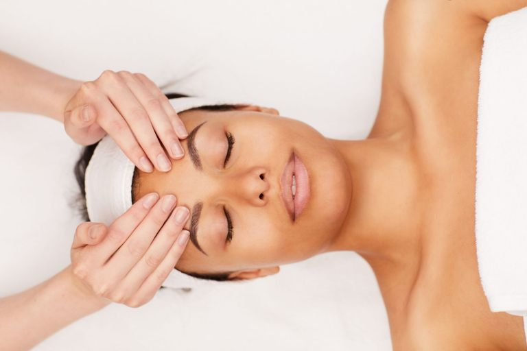 Woman enjoying a relaxing massage - but are massages good for you?