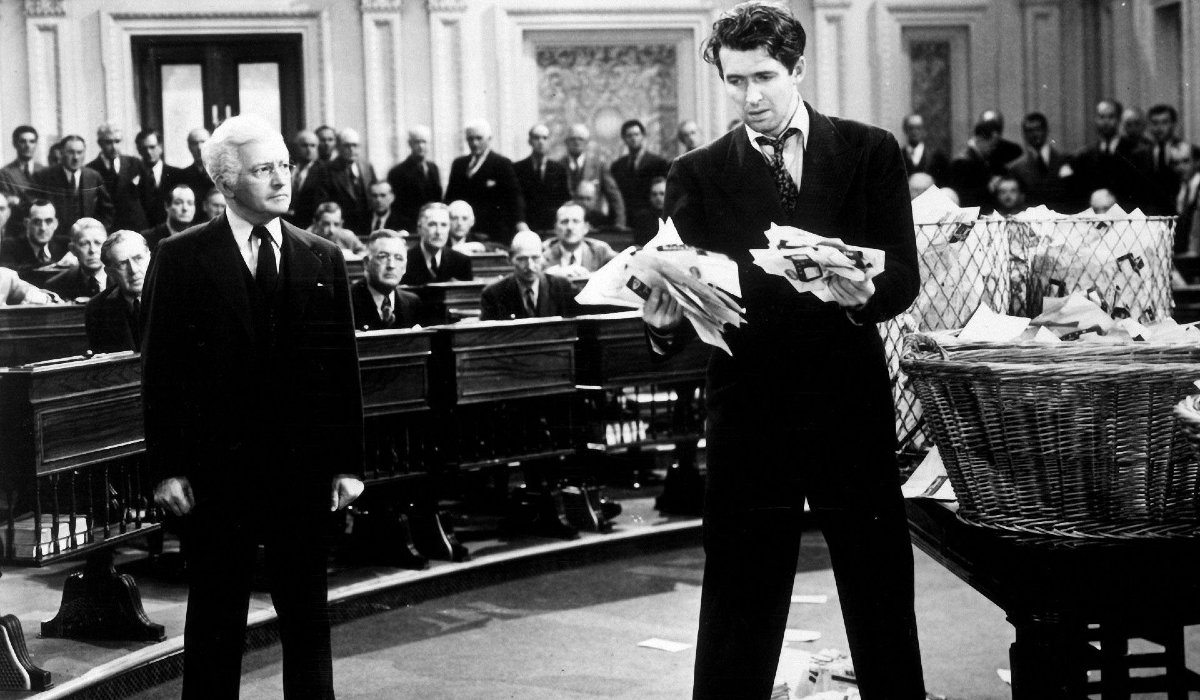 Mr. Smith Goes To Washington Claude Rains at Jimmy Stewart clutching handfuls of letters