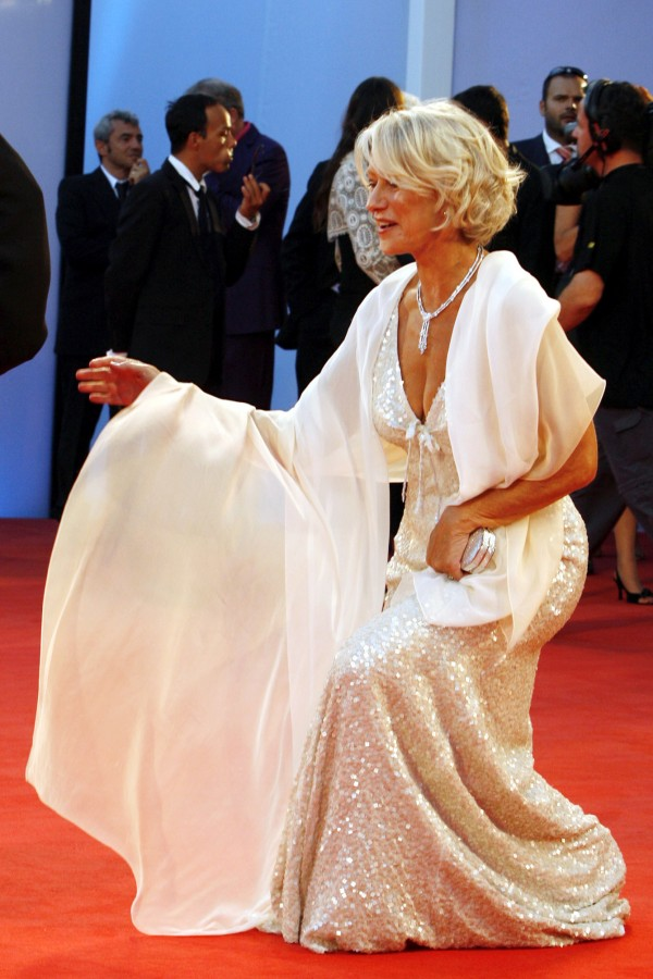 Helen Mirren practises her curtsey at The Queen premiere in Venice in 2006