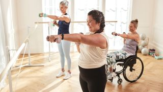 Best fitness trackers 2021: Three woman, including a wheelchair user, track their upper body strength training with the Fitbit Luxe
