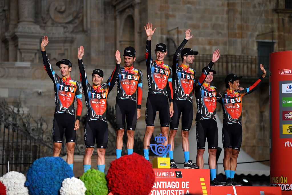 SANTIAGO DE COMPOSTELA SPAIN SEPTEMBER 05 Yukiya Arashiro of Japan Damiano Caruso of Italy Jack Haig of Australia Gino Mder of Switzerland Mark Padun of Ukraine Wouter Poels of Netherlands Jan Tratnik of Slovenia and Team Bahrain Victorious celebrates winning the best team on the podium ceremony in the Plaza del Obradoiro with the Cathedral in the background after the 76th Tour of Spain 2021 Stage 21 a 338 km Individual Time Trial stage from Padrn to Santiago de Compostela lavuelta LaVuelta21 ITT on September 05 2021 in Santiago de Compostela Spain Photo by Stuart FranklinGetty Images