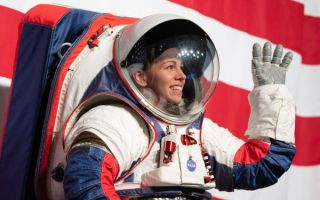 Kristine Davis, a spacesuit engineer at NASA's Johnson Space Center, wearing a ground prototype of NASA's new Exploration Extravehicular Mobility Unit (xEMU), is seen during a demonstration of the suit, Tuesday, Oct. 15, 2019 at NASA Headquarters in Washington.