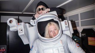 A shot of 100 gecs in a spaceship