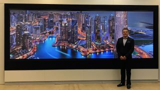 "Prysm's founder and CTO Dr. Roger Hajjar with the Prysm Laser Phosphor Display (LPD) 6K Series 225""."