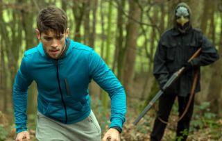 Gotcha! In Emmerdale Joe is ambushed by an armed masked man in the woods
