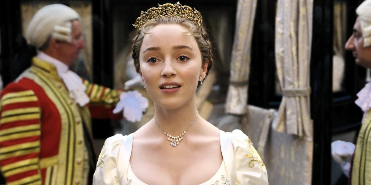 Daphne Bridgerton (Phoebe Dynevor) looks on in 'Bridgerton'