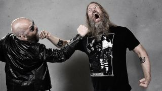 A photograph of Amon Amarth and Grand Magus playfighting