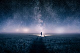 a man looking up at night sky