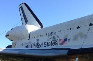 Racial and political graffiti was sprayed on the side of the space shuttle Independence replica at Space Center Houston on Wednesday, Nov. 27, 2013.