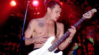 Flea on stage at the Aragon Ballroom in Chicago, Illinois, December 6, 1991