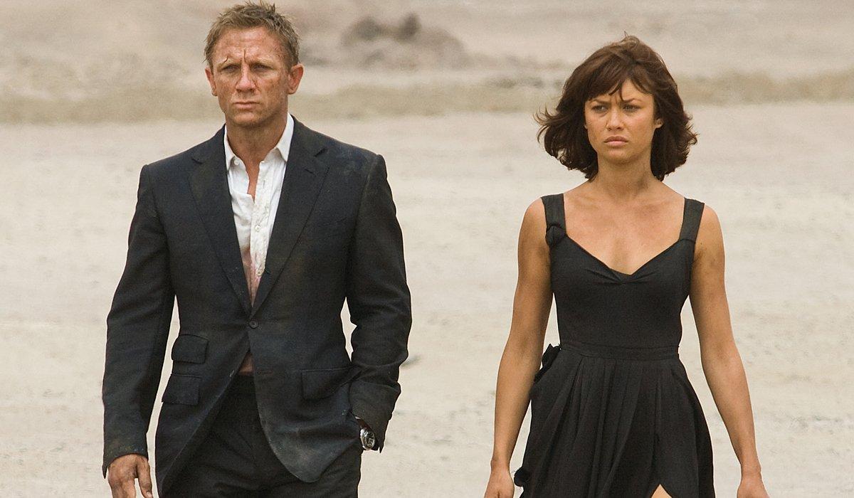 Quantum of Solace Daniel Craig and Olga Kurylenko walking through the desert