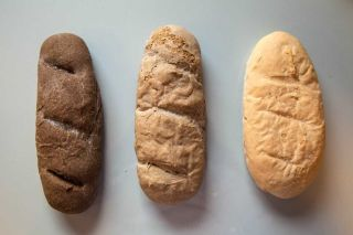 Three breads produced with different blends of wheat four and, from left to right, 30 percent, 10 percent and zero percent cricket powder. The more cricket powder was used, the darker the color.