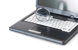 Laptop with a magnifying glass