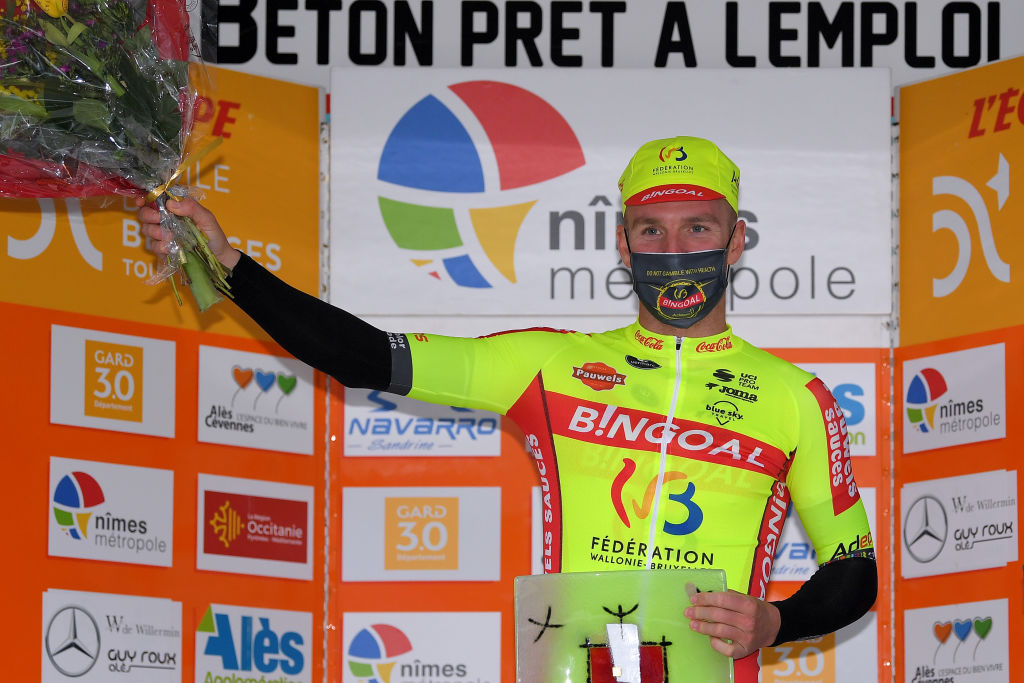 LA CALMETTE FRANCE FEBRUARY 04 Podium Timothy Dupont Belgium and Team Bingoal WB winner of 2nd stage celebrate during the 51st toile de Bessges Tour du Gard 2021 Stage 2 a 154km stage from SaintGenis to La Calmette Trophy Flowers Mask Covid safety measures Hostess EDB2020 on February 04 2021 in La Calmette France Photo by Luc ClaessenGetty Images