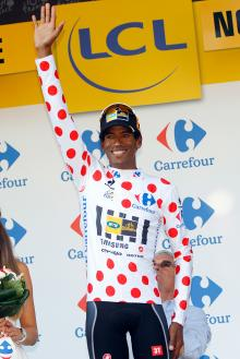 Daniel Teklehaimanot (MTN-Qhubeka) wears the polka dot jersey on the stage 6 podium.