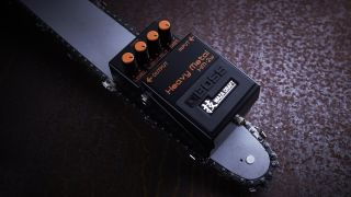 Boss HM-2W Waza Craft reissue pedal on a chainsaw