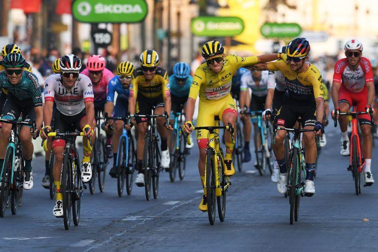 Tadej Pogačar gets congratulated by Primož Roglič after winning the Tour de France 2020