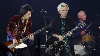 Rolling Stones' Ron Wood (L), Keith Richards (C) and Charlie Watts perform during the inauguration concert of the U Arena hall, new stadium of the French Rugby Union club Racing 92 in Nanterre on October 19, 2017