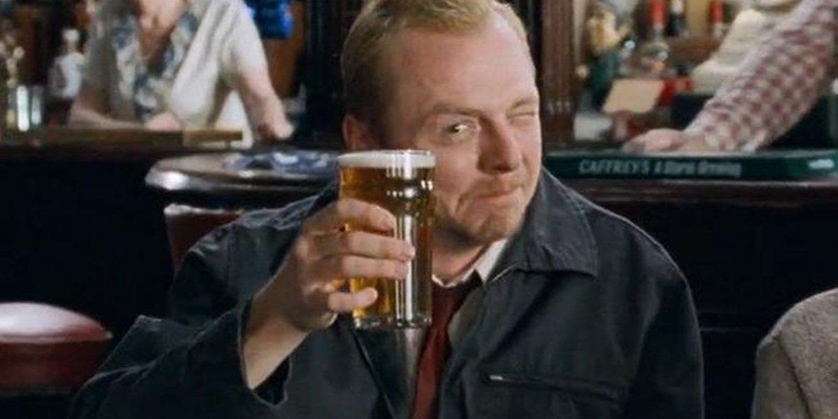 Shaun raises a pint at the winchester Shaun of the Dead