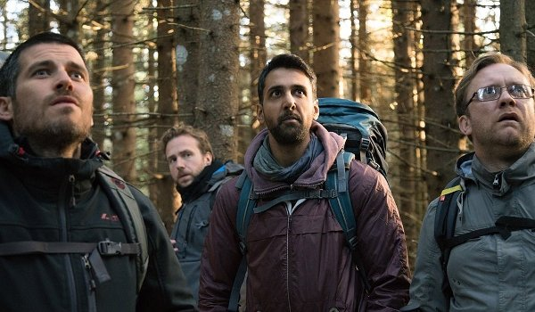 The Ritual Paul Reid Rafe Spall Arsher Ali Sam Troughton see something in the woods that startles th