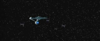 Starship Enterprise Chased by TIE Fighters