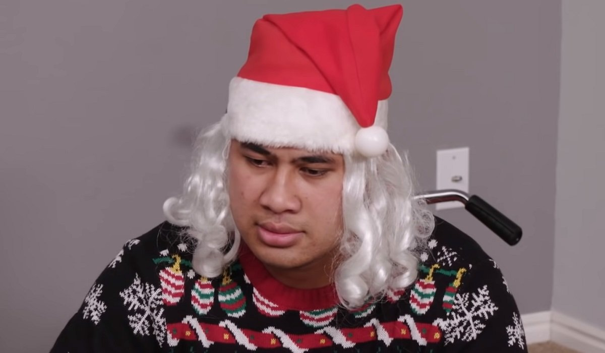 Asuelu looking sad in a santa hat 90 Day Fiance: Happily Ever After? TLC