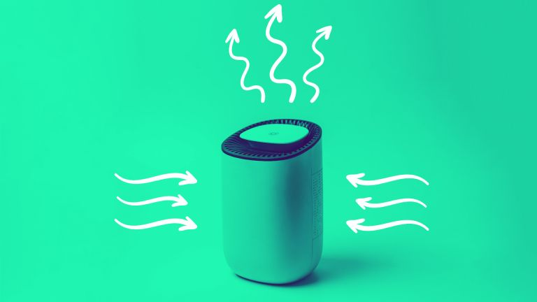 how air purifiers work, air purifier on green background