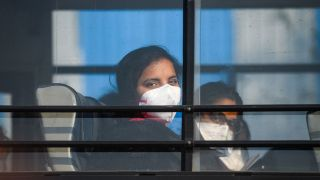 Students are taken to a special army facility as a precaution against the possible coronavirus infection on their return from China, at Indira Gandhi International Airport, on Feb. 1, 2020 in New Delhi, India. The passengers were evacuated from Wuhan and will be kept in isolation for 14 days in Chhawla in Delhi.