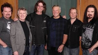 Emmett with Lifeson, LaBrie and colleagues
