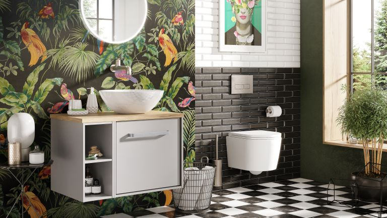 Green bathroom design with printed wallpaper and checkered floor tiles