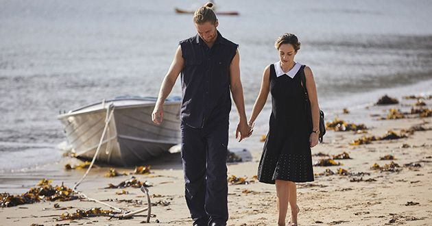 Tori Morgan and Ash Ashford share a happy moment on the beach in Home and Away.