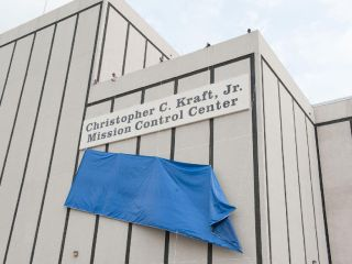 After more than 45 years of service to the nation's space program, the naming for NASA's mission control center became official with the unveiling of a new nameplate on the building, designating the legendary building as the Christopher C. Kraft, Jr., Mis