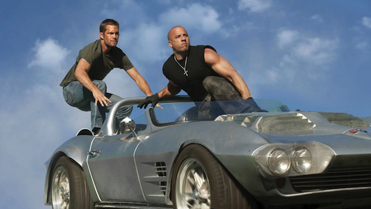 Paul Walker and Vin Diesel perform one of the franchise's most iconic stunts