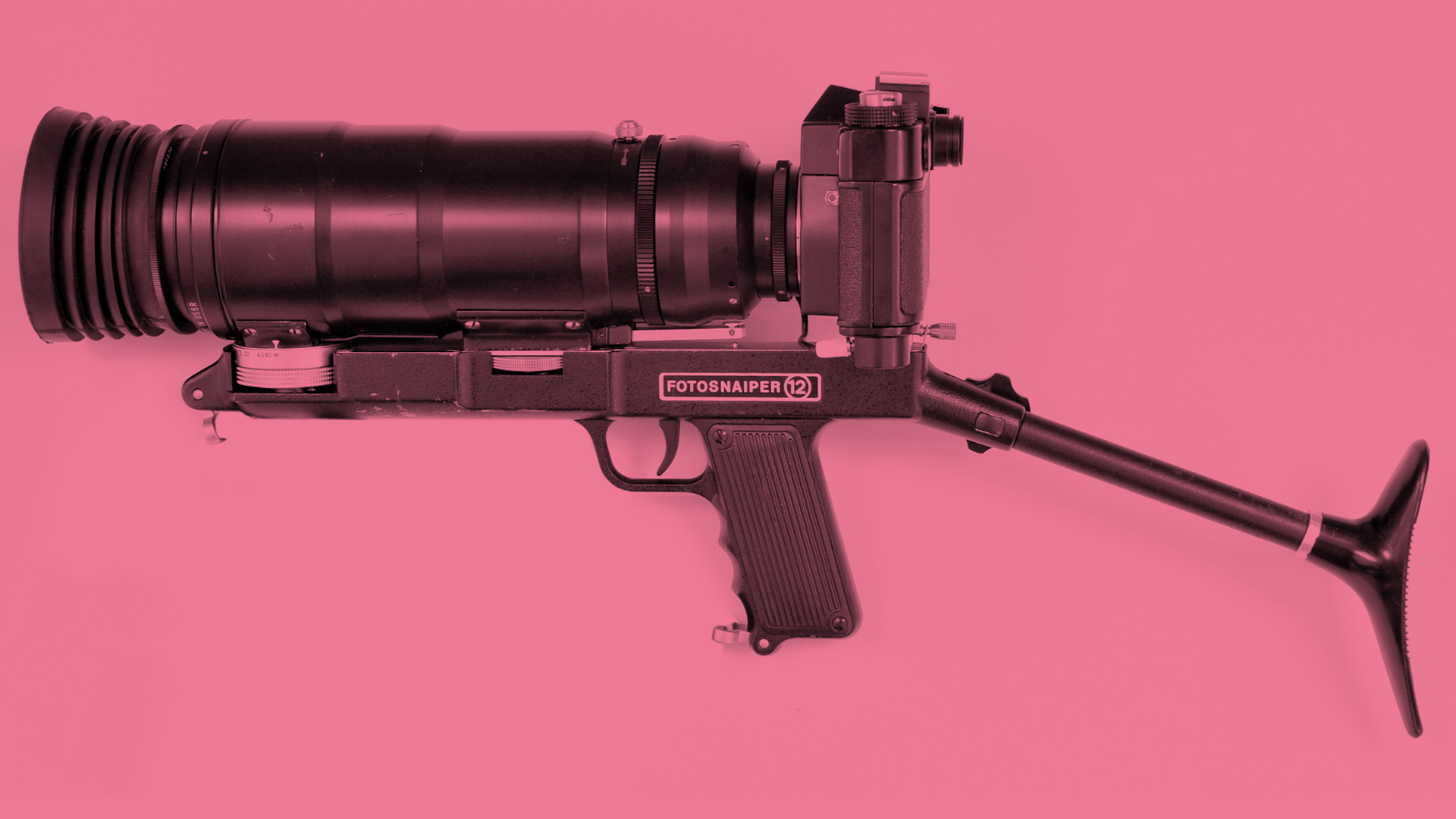 The side of the Zenit Fotosniper camera on a pink background