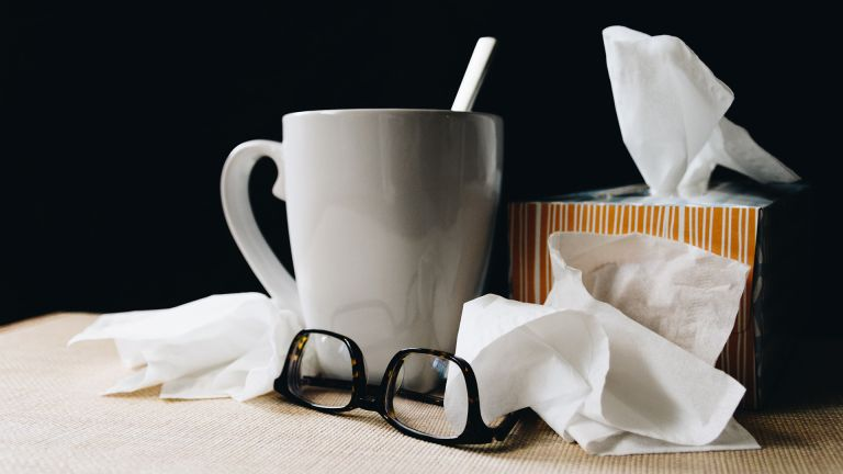 tissues, a mug and a pair of glasses