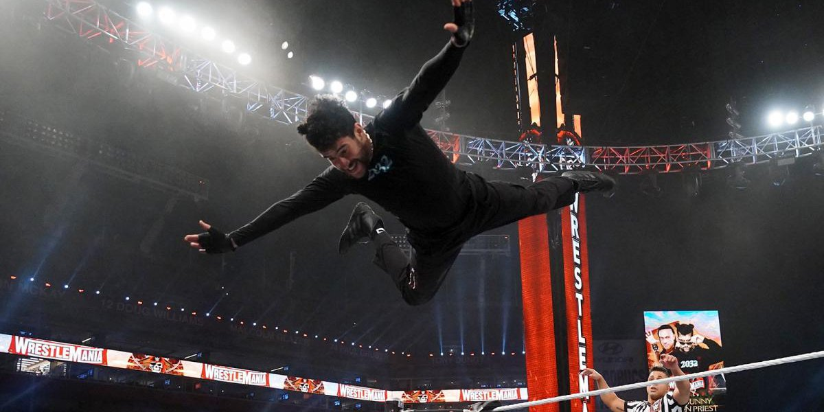 Bad Bunny diving off the top rope at WrestleMania 37