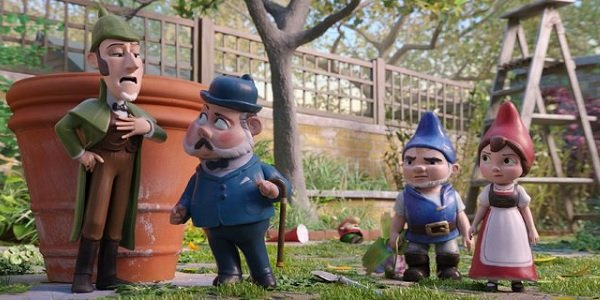 Sherlock Gnomes Sherlock and Watson beside Gnomeo and Juliet in the garden