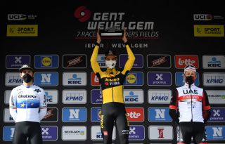 WEVELGEM BELGIUM MARCH 28 Podium Giacomo Nizzolo of Italy and Team Qhubeka Assos Wout Van Aert of Belgium and Team Jumbo Visma Matteo Trentin of Italy and UAE Team Emirates Celebration during the 83rd GentWevelgem in Flanders Fields 2021 Mens Elite a 254km race from Ypres to Wevelgem Trophy Celebration Mask Covid Safety Measures GWE21 GWEmen FlandersClassic on March 28 2021 in Wevelgem Belgium Photo by Tim de WaeleGetty Images