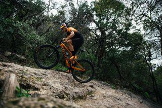 Payson McElveen climbs a ledge on his mountain bike